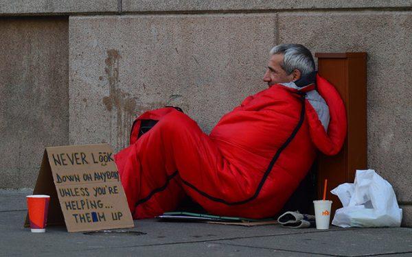 A homeless man sleeping rough