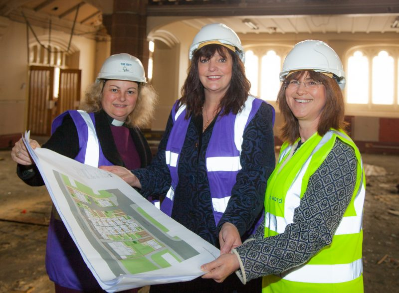 Bronwen Rapely, Deputy Mayor Cllr Ann O'Byrne and Rev'd Dr Shannon Ledbetter look at plans for the new Kingsley Road development in Toxteth, Liverpool