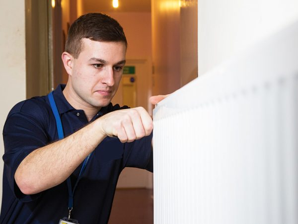 Gas fitter maintaining a property