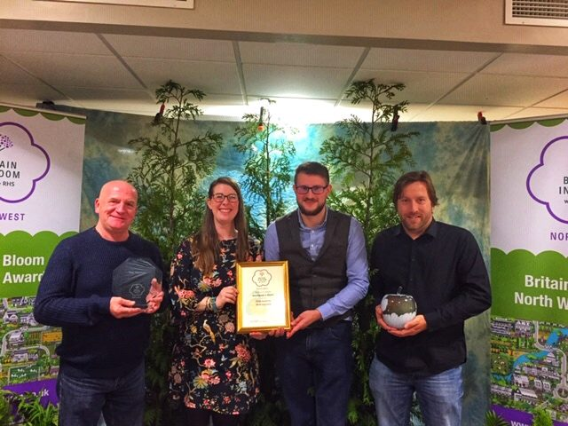 Representatives from Onward collect their prizes at the North West in Bloom Awards
