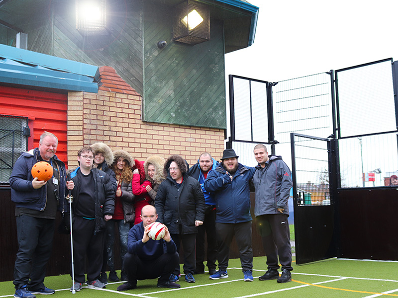Members of Daisy Inclusive UK with their new floodlights