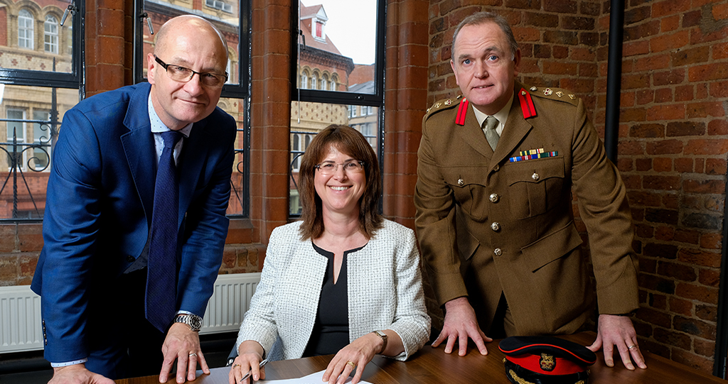 Onward chief executive Bronwen Rapley signs the Armed Forces Covenant